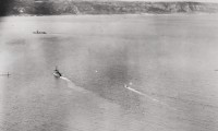 Image of Sinking of U205 - Submarine crew surrender to HMS Easton, 1943