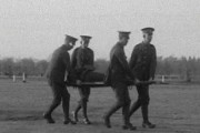 Soldiers practice stretcher and bandage drill, Pathe film clip