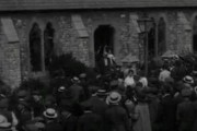 Pathe: incensed patriots besiege pacifists in a London church.
